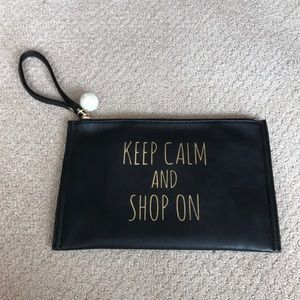 """KEEP CALM AND SHOP ON"" Black Wristlet"